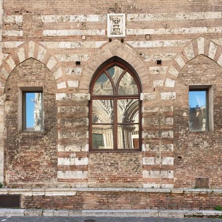 windows reflecting the Duomo in Siena