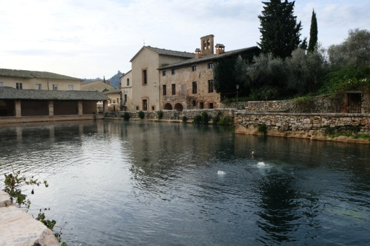 bubbling spring in central square of Tuscan village