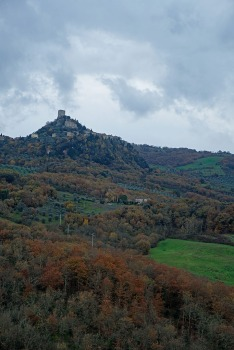view of Renaissance castle from across a small valley