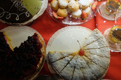various cakes, cookies and desserts on display