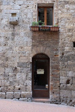 Renovated doorway and window in Renaissance building, Tuscany